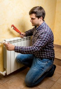 male technician working on radiator