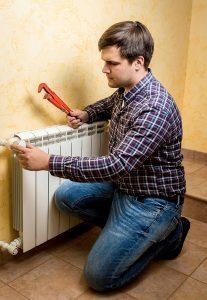 male technician working on radiator