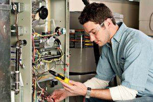 Service-technician-testing-a-furnace
