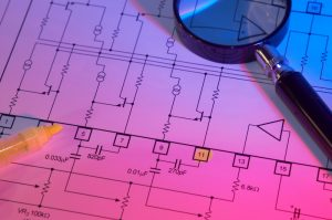 electrical-blueprint-with-magnifying-glass