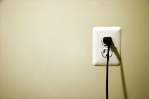 cord -plugged-into-electrical-outlet