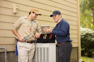 two-technicians-working-on-hvac-system