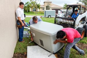 technicians-installing-whole-house-generator
