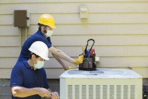 two-techs-working-on-ac-unit