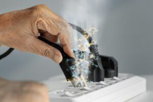 plug-sparking-as-it-goes-into-power-strip